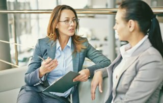 HR managers asking questions of a new hire